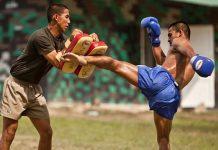 nak muay kickpad using a roundhouse kick